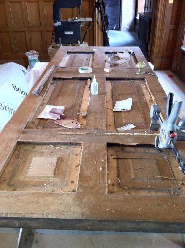Oak door restoration - door removed and stripped