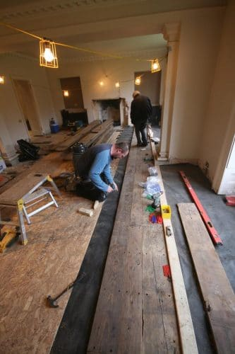Reclaimed oak floor restoration - laying the floor