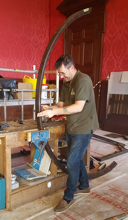 Mark, one of our team, removing old glue from a section of the Lunette