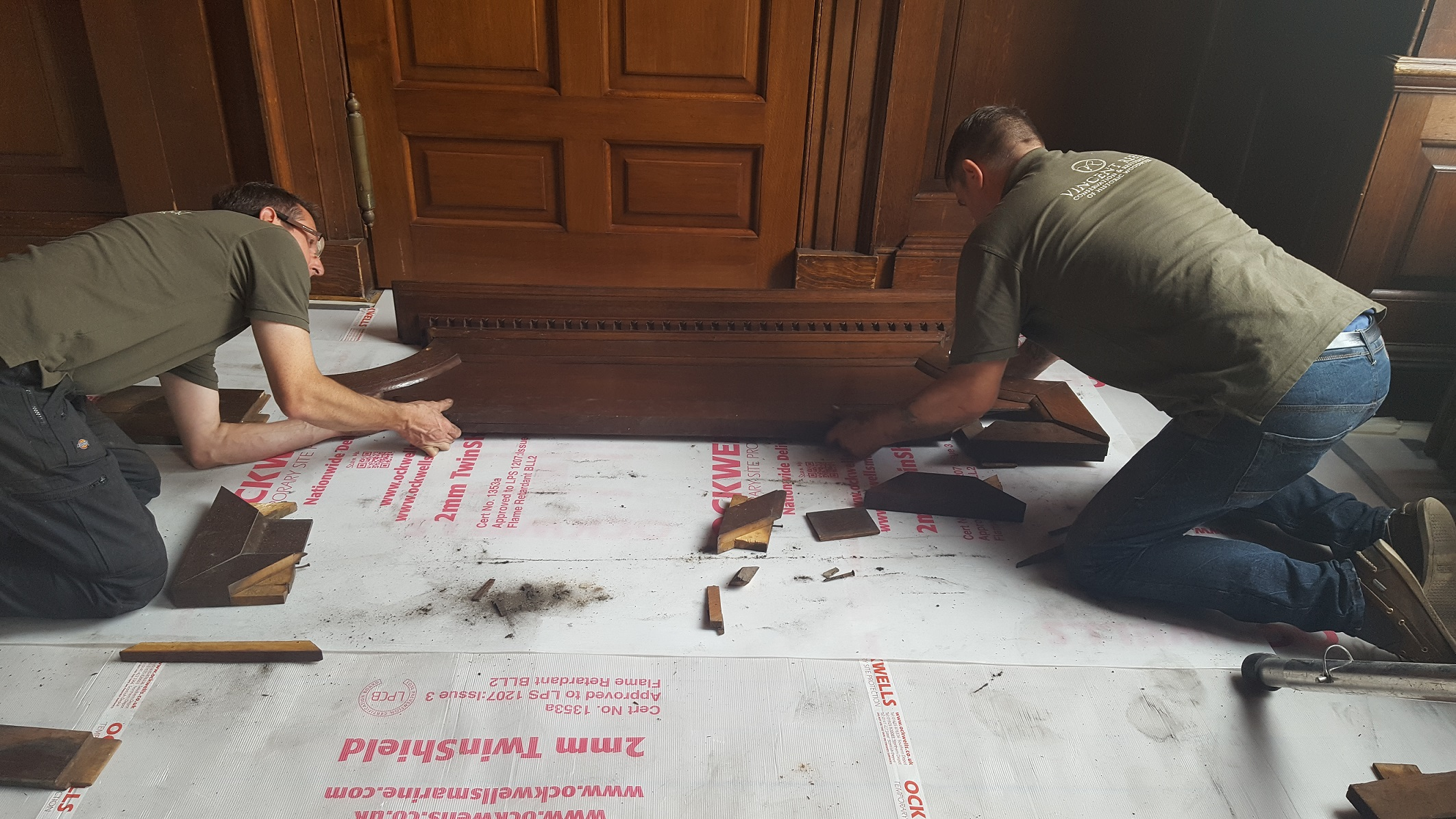 Our team fitting the sections of the central pediment into the right places